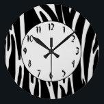 "Zebra Print Pattern Wall Clock<br><div class=""desc"">Custom Wall Clock has a fun black and white animal print stripes pattern with matisse font clock face.</div>"