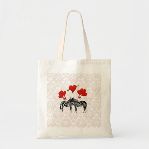 Zebras and hearts on pink damask bags