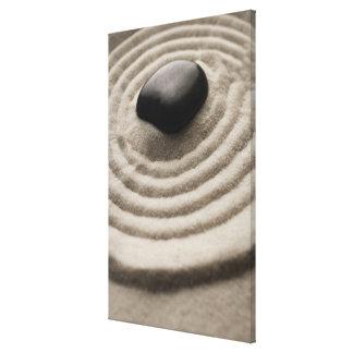 zen garden with pebble detail on raked sand canvas print