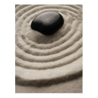 zen garden with pebble detail on raked sand postcard