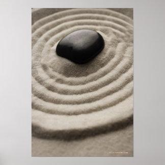 zen garden with pebble detail on raked sand poster