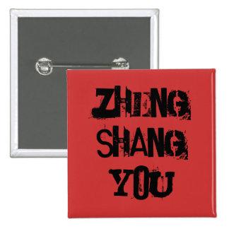 Zheng Shang usted en negro en el botón rojo Pin Cuadrado