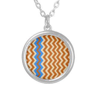 Zigzags anaranjados oxidados con el azul colgante redondo
