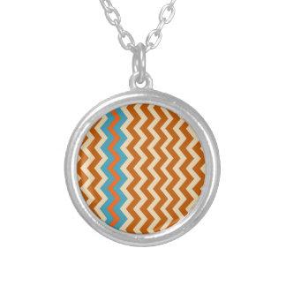 Zigzags terrosos de la cerámica con la frontera colgante redondo