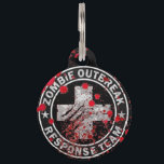 """Zombie Outbreak Response Team Medic Pet ID Tag<br><div class=""""desc"""">Preparing for the zombie apocalypse? Tag your dog to let others know that in case of emergency, your dog is fully prepared to face hoards of the undead. Each of our pet ID tags are designed and illustrated by artists from all over the globe, and printed with affection and care...</div>"""