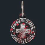 "Zombie Outbreak Response Team Medic Pet ID Tag<br><div class=""desc"">Preparing for the zombie apocalypse? Tag your dog to let others know that in case of emergency, your dog is fully prepared to face hoards of the undead. Each of our pet ID tags are designed and illustrated by artists from all over the globe, and printed with affection and care...</div>"
