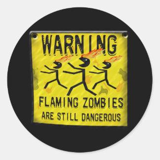Zombis llameantes que advierten a los pegatinas etiquetas redondas