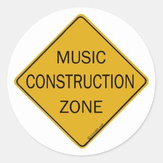 Zona de la construcción de la música pegatina redonda