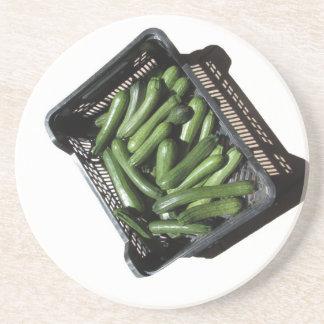 Zucchini in box on white background sandstone coaster