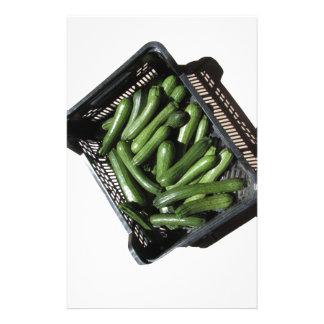 Zucchini in box on white background stationery