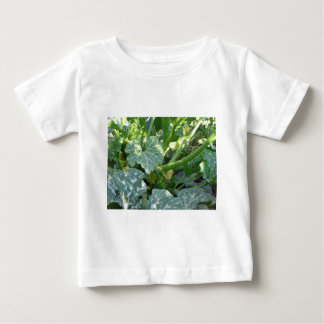 Zucchini plant in blossom in the garden in Tuscany Baby T-Shirt