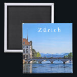"""Zurich. Limmat. City Hall and Bridge. Magnet<br><div class=""""desc"""">Zurich. Limmat. City Hall and Bridge. Travel. Europe. Switzerland. Zurich (German Z&#252;rich, Swiss Z&#252;ri, French Zurich, Italian Zurigo) is a city in the north-east of Switzerland. The capital of the German-speaking canton of Zurich and the administrative center of the same district. Zurich is the largest city in the country, located...</div>"""